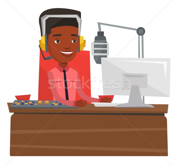 Genç çalışma radyo kulaklık istasyon mikrofon Stok fotoğraf © RAStudio