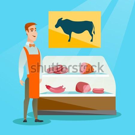 Butcher offering fresh meat in butchershop. Stock photo © RAStudio