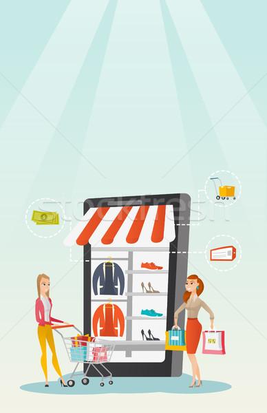 Women walking in store that looks like a tablet. Stock photo © RAStudio