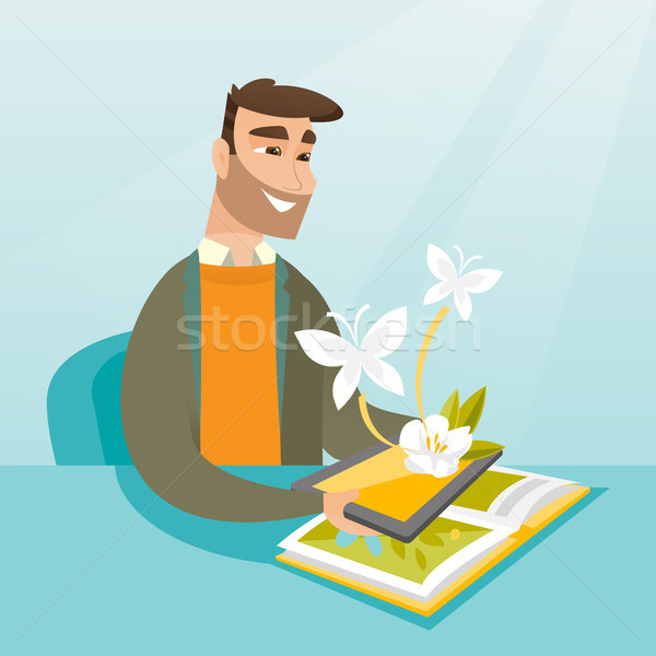 Young man holding tablet computer above the book. Stock photo © RAStudio