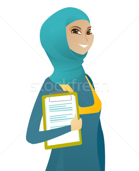Business woman holding clipboard with documents. Stock photo © RAStudio