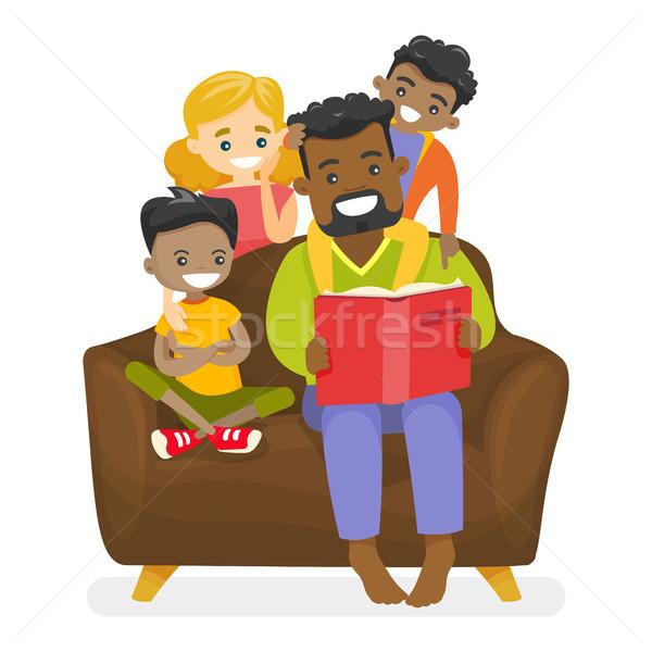 Father reading a book to multiethnic children. Stock photo © RAStudio