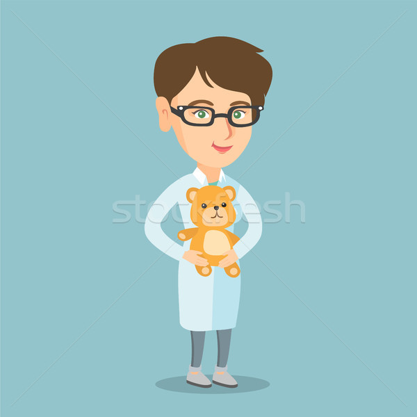 Caucasian pediatrician doctor holding a teddy bear Stock photo © RAStudio