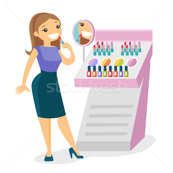 Young caucasian white woman buying lipstick. Stock photo © RAStudio