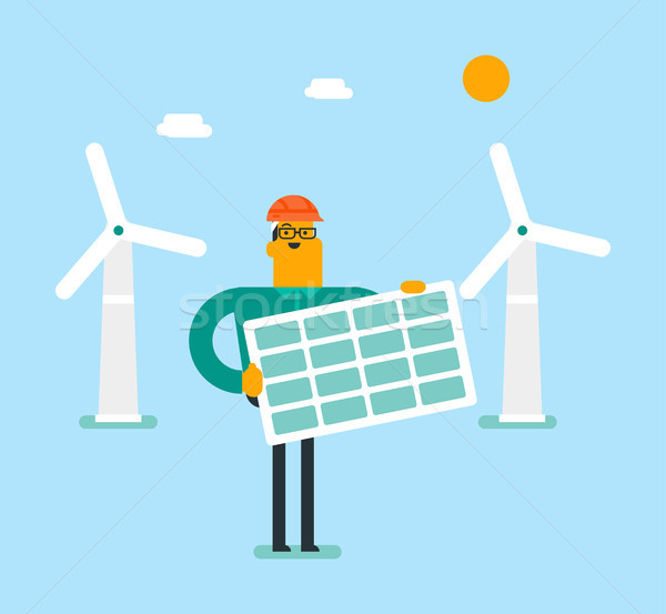 Young caucasian white man holding solar panel. Stock photo © RAStudio