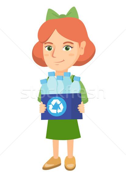 Lány tart újrahasznosítás tároló tele műanyag Stock fotó © RAStudio