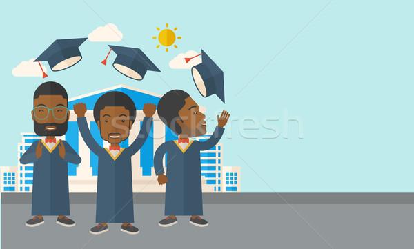 Three men throwing graduation cap. Stock photo © RAStudio