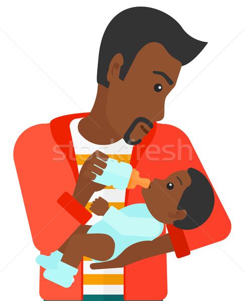 Man feeding baby. Stock photo © RAStudio