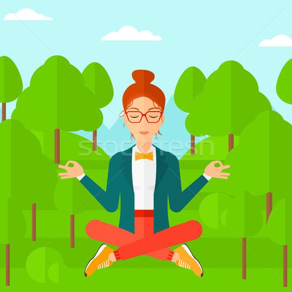 Business woman meditating in lotus pose. Stock photo © RAStudio