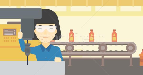 ストックフォト: 女性 · 作業 · マシン · アジア · ワークショップ · 工場