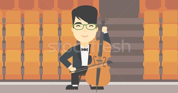 Homem jogar violoncelo asiático moço violoncelista Foto stock © RAStudio