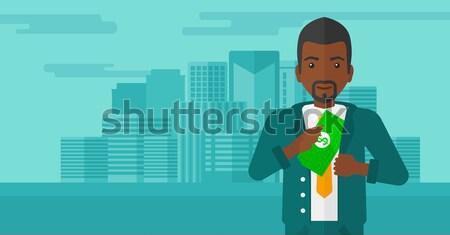 Homme argent poche affaires ville cacher Photo stock © RAStudio