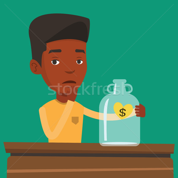 Bankrupt businessman looking at empty money box. Stock photo © RAStudio