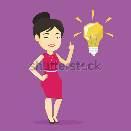 Doctor pointing at bright idea light bulb. Stock photo © RAStudio