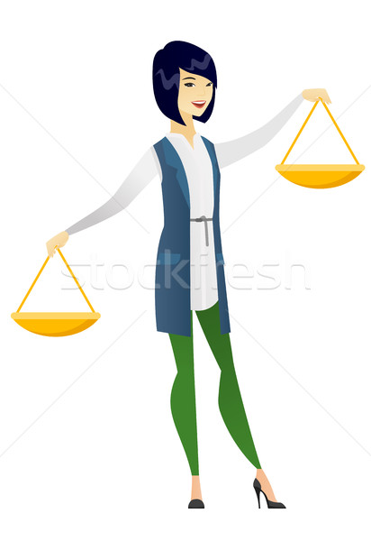 Asian business woman holding balance scale. Stock photo © RAStudio