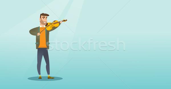 человека играет скрипки молодым человеком скрипач классическая музыка Сток-фото © RAStudio