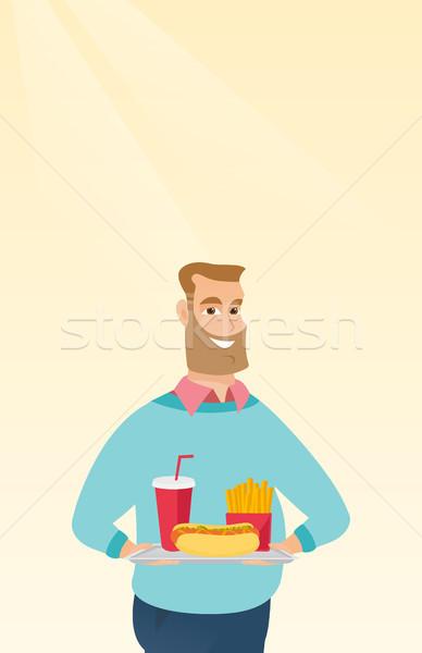 Man dienblad vol fast food kaukasisch Stockfoto © RAStudio