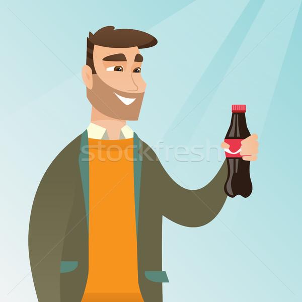 Giovane bere soda uomo Foto d'archivio © RAStudio