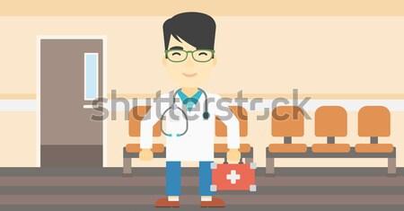 Doctor with first aid box. Stock photo © RAStudio