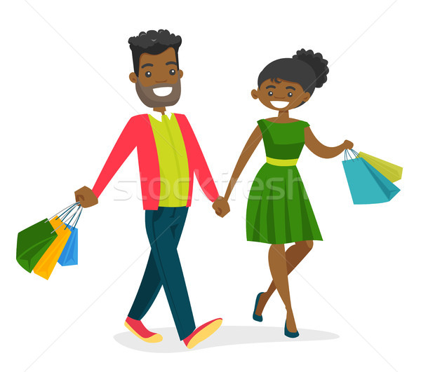 African-american people walking with shopping bags Stock photo © RAStudio