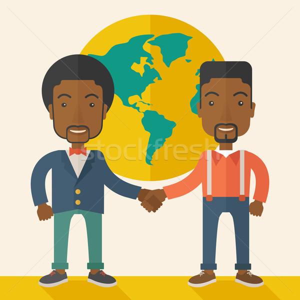Two black guys happily handshaking. Stock photo © RAStudio