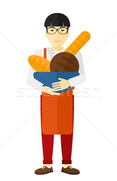 Bakery owner with bread. Stock photo © RAStudio