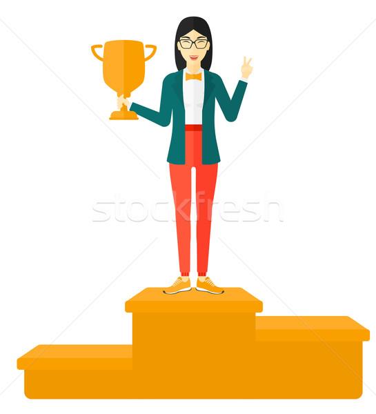 Cheerful woman on pedestal. Stock photo © RAStudio
