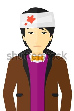 Man with injured head. Stock photo © RAStudio