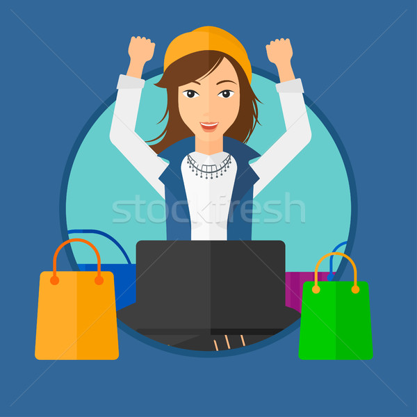 Woman shopping online using her laptop. Stock photo © RAStudio