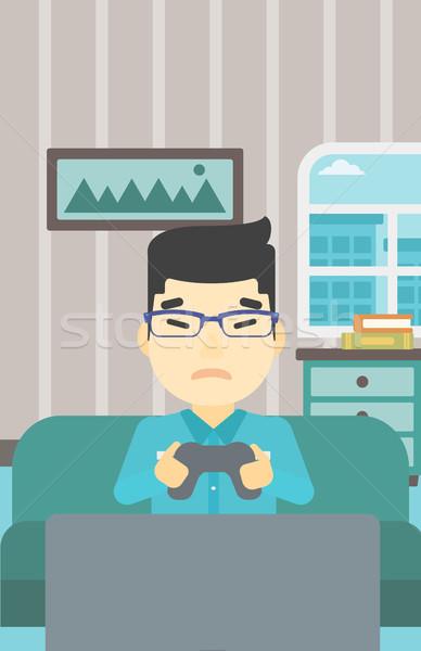 Photo stock: Homme · jouer · jeu · vidéo · asian · agressif · télévision