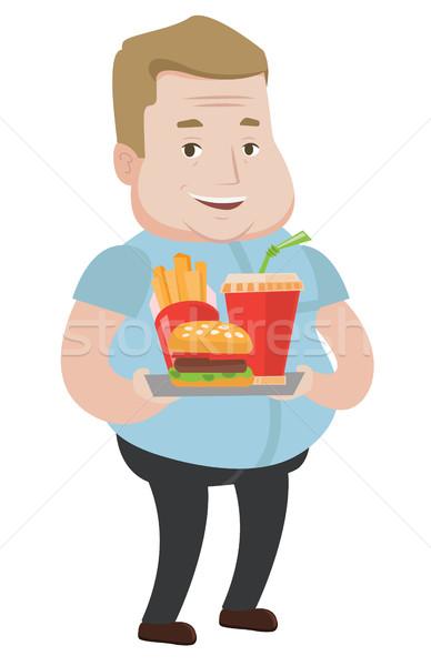 Man dienblad vol fast food gelukkig Stockfoto © RAStudio
