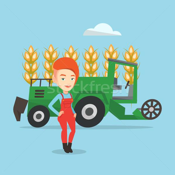 Farmer standing with combine on background. Stock photo © RAStudio