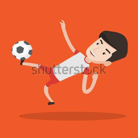 Calciatore calci palla giovani gioco Foto d'archivio © RAStudio