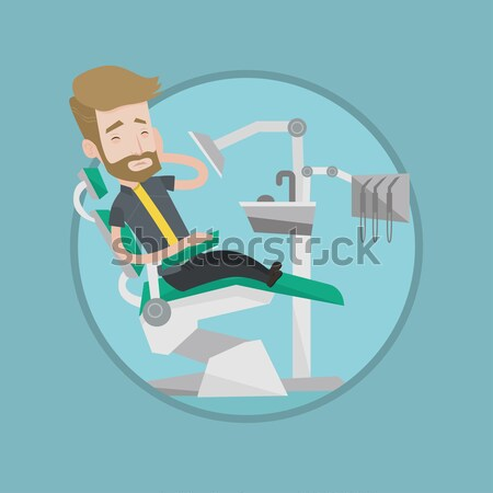 Man suffering from toothache in dental chair. Stock photo © RAStudio