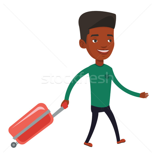 African man walking with suitcase. Stock photo © RAStudio