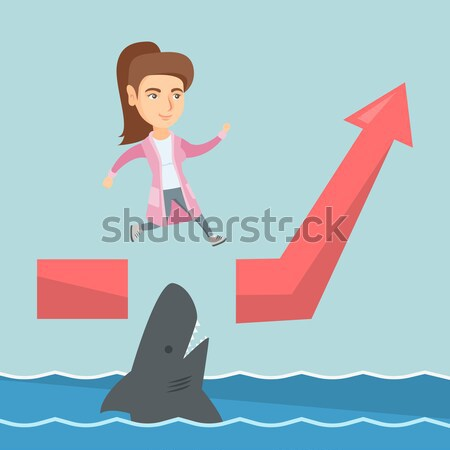 Business man jumping over ocean with shark. Stock photo © RAStudio