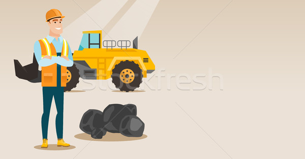 Miner with a big excavator on background. Stock photo © RAStudio