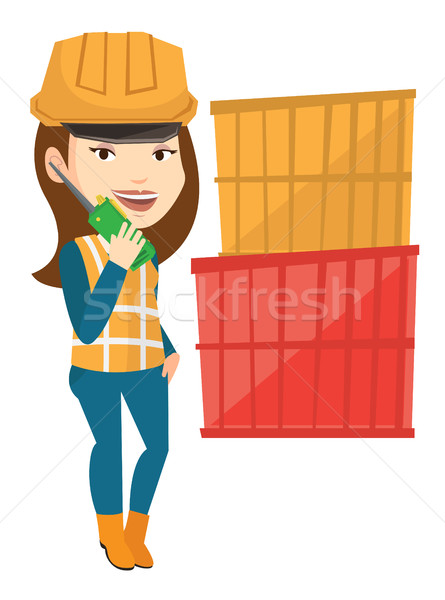 Port worker talking on wireless radio. Stock photo © RAStudio