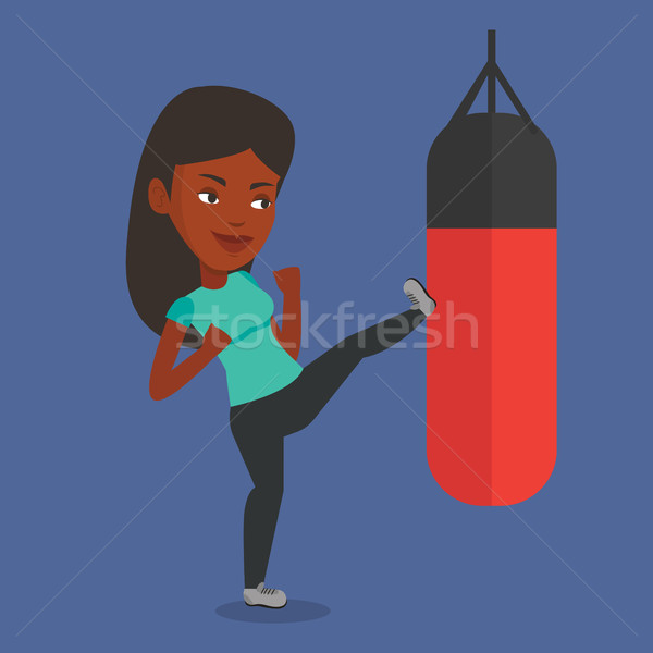 Woman exercising with punching bag. Stock photo © RAStudio