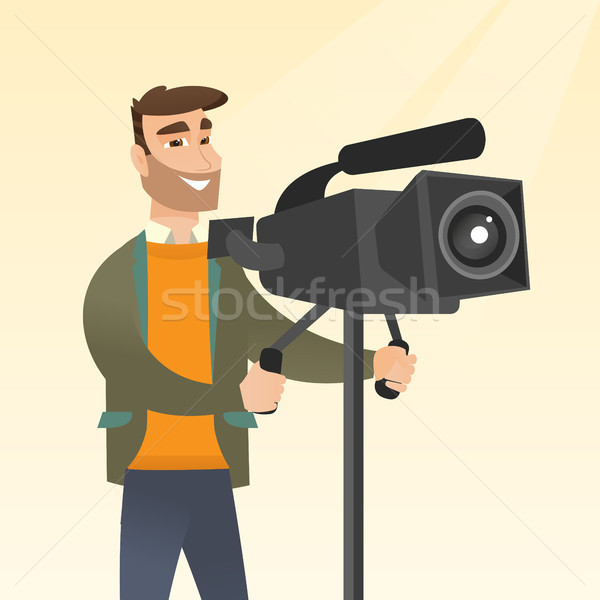 Stock photo: Cameraman with a movie camera on tripod.