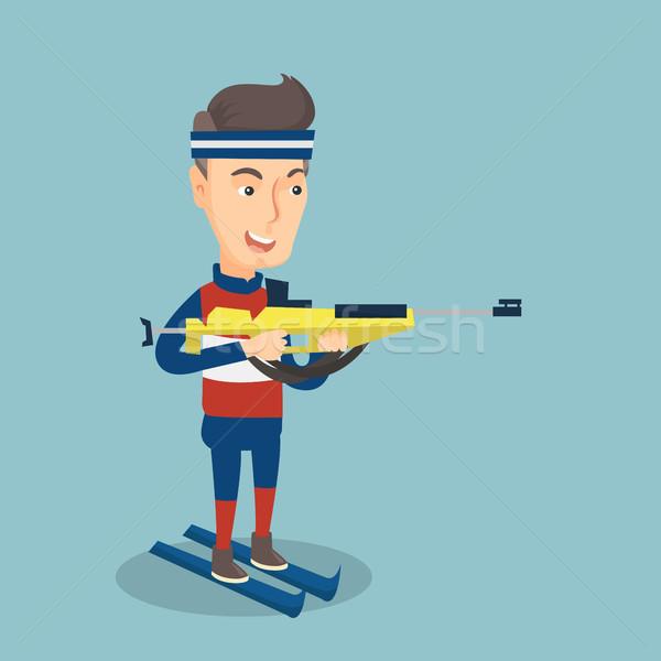 Cheerful biathlon runner aiming at the target. Stock photo © RAStudio