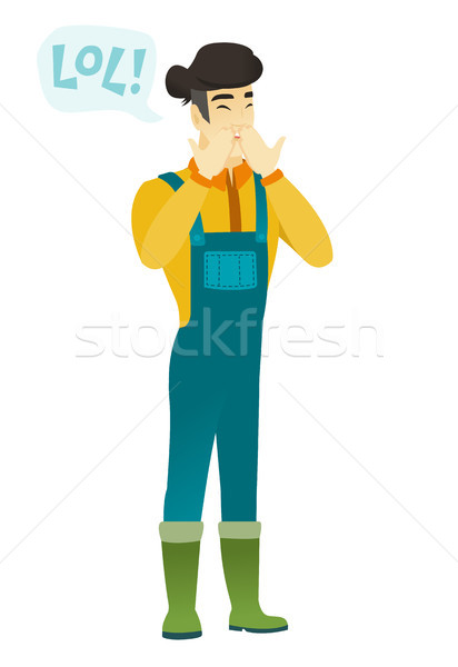 Young asian farmer laughing out loud. Stock photo © RAStudio