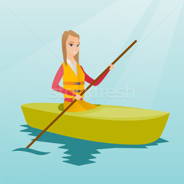 Young caucasian woman travelling by kayak. Stock photo © RAStudio