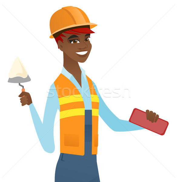African bricklayer working with spatula and brick. Stock photo © RAStudio