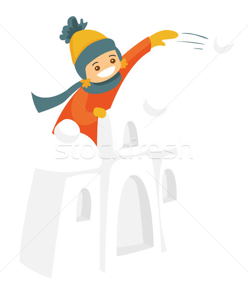 Little boy in snow castle playing snowball fight. Stock photo © RAStudio