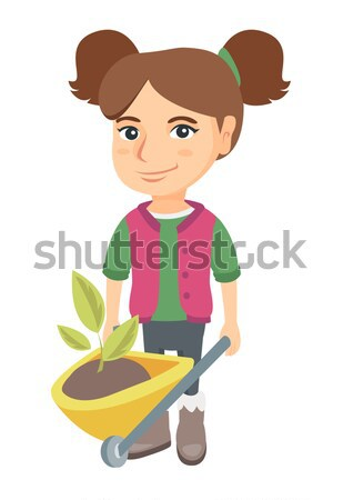 Boy pushing wheelbarrow with soil and plant. Stock photo © RAStudio
