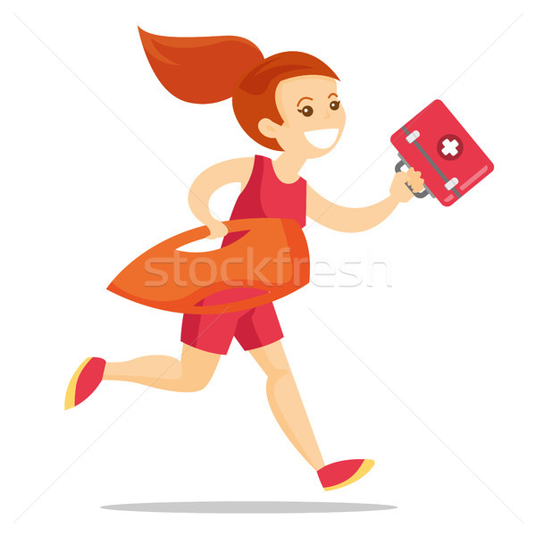 Caucasian lifeguard running with first aid box. Stock photo © RAStudio