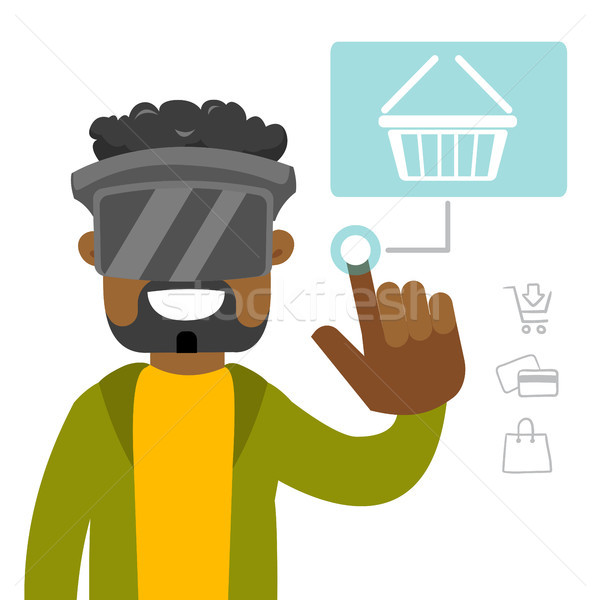 A black man in virtual reality headset doing online shopping. Stock photo © RAStudio