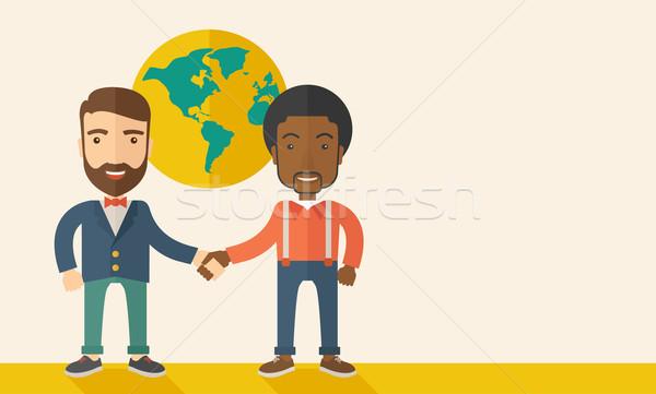 American and black guy happily handshaking. Stock photo © RAStudio