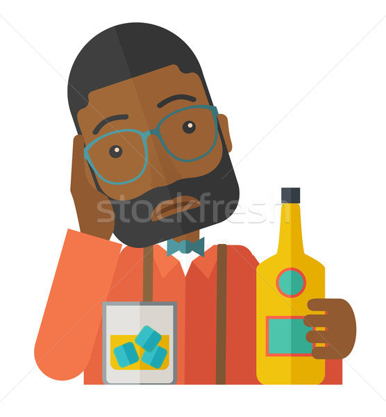 Stock photo: Sad african man alone in the bar drinking beer.